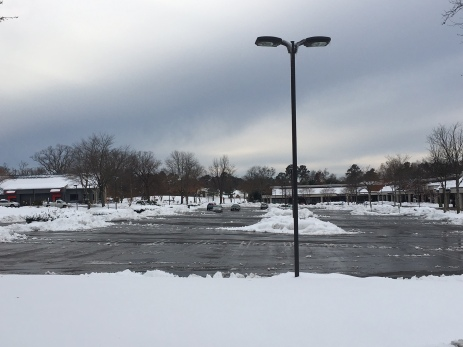 stony parking lot after snow removal 12 10 18